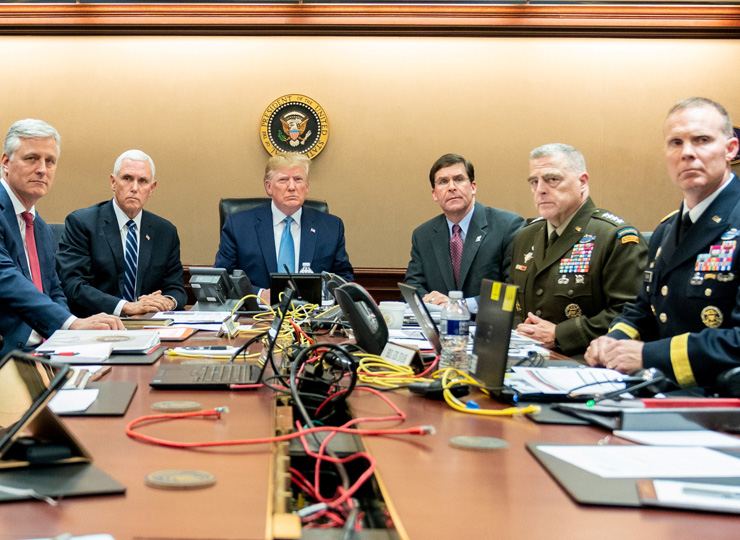 U.S. President Donald Trump (center), U.S. Vice President Mike Pence (second from left), U.S. Secretary of Defense Mark Esper (second from right), along with members of the national security team watch as U.S. Special Operations forces close in on ISIS leader Abu Bakr al-Baghdadi, in the Situation Room of the White House on Oct. 26.