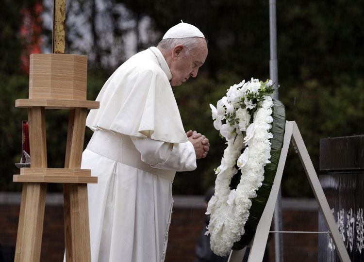 Pope Francis offers a prayer after laying a wreath at Nagasaki's Atomic Bomb Hypocenter Park on Nov. 24.