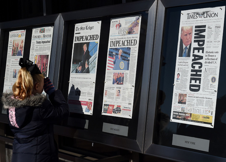 Newspaper front pages are on display at the Newseum in Washington, D.C., on Dec. 19, after U.S. President Donald Trump's historic impeachment by the House of Representatives on Dec. 18.