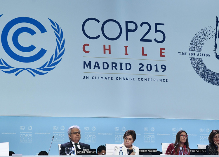 Chile's Minister of Environment and U.N. Climate Change Conference COP25 President Carolina Schmidt (second from right) attends COP25's closing plenary session in Madrid on Dec. 15. Seated at her right is U.N. Climate Change Executive Secretary Patricia Espinosa.