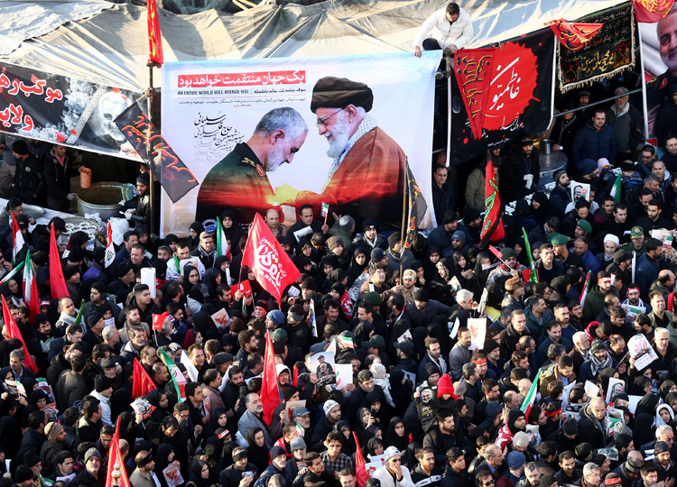 Iranian people attend a funeral procession Jan. 6 in Tehran for Gen. Qassem Soleimani, head of the country's elite Quds Force, and Iraqi militia commander Abu Mahdi al-Muhandis.