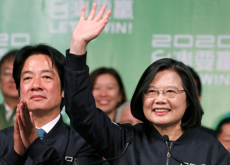 Incumbent Taiwan President Tsai Ing-wen (right) and Vice President-elect William Lai celebrate their election victory at a rally outside Democratic Progressive Party headquarters in Taipei on Jan. 11.