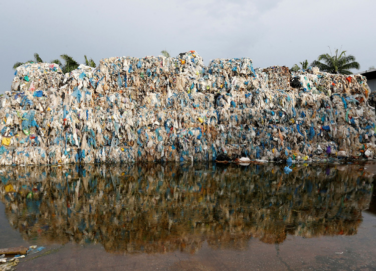 This file photo taken Oct. 14, 2018, shows plastic waste piled outside an illegal recycling factory in Jenjarom, Kuala Langat, Malaysia.