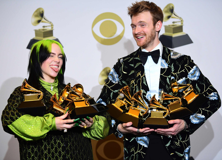 American singer-songwriter Billie Eilish (left) and Finneas pose with the awards they won during the 62nd Annual Grammy Awards on Jan. 26 in Los Angeles.