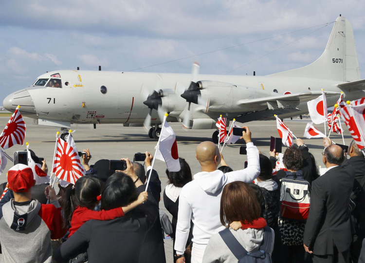 A Maritime Self-Defense Force P-3C patrol plane departs from an airbase in Naha on Jan. 11 for the SDF's first long-term intelligence-gathering mission abroad.
