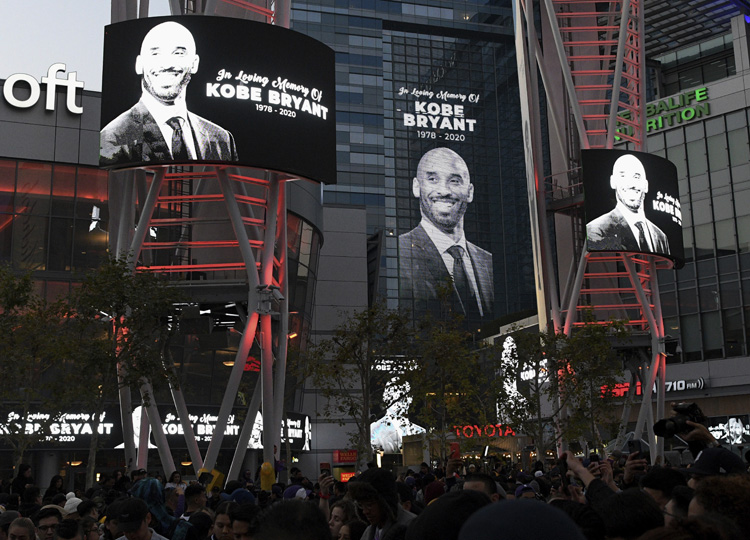 Electronic signs honor Kobe Bryant at the L.A. Live entertainment complex in Los Angeles on Jan. 26, following reports of his death in a helicopter crash in Southern California.