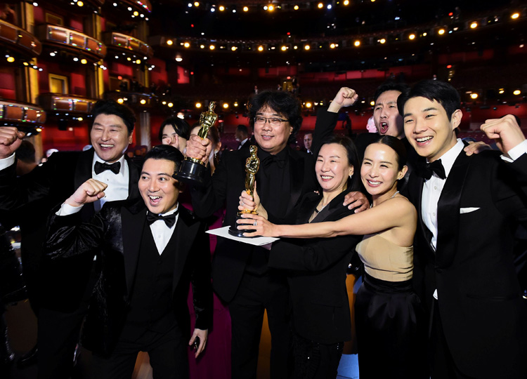 Bong Joon Ho (center) and the cast of Parasite pose at the 92nd Academy Awards in Hollywood, Los Angeles, on Feb. 9.