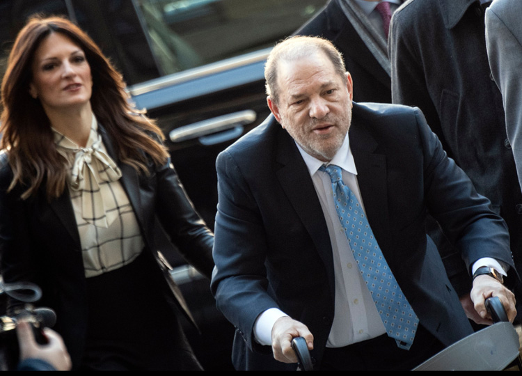 Harvey Weinstein arrives at the Manhattan Criminal Court on Feb. 24 in New York City. Behind him is defense attorney Donna Rotunno.