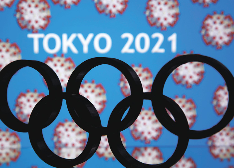 "A 3D-printed Olympics logo is seen in front of the words ""Tokyo 2021"" in this illustration taken March 24."