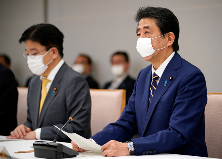 Prime Minister Shinzo Abe speaks during a meeting of a coronavirus task force at the prime minister's official residence in Tokyo on April 7.