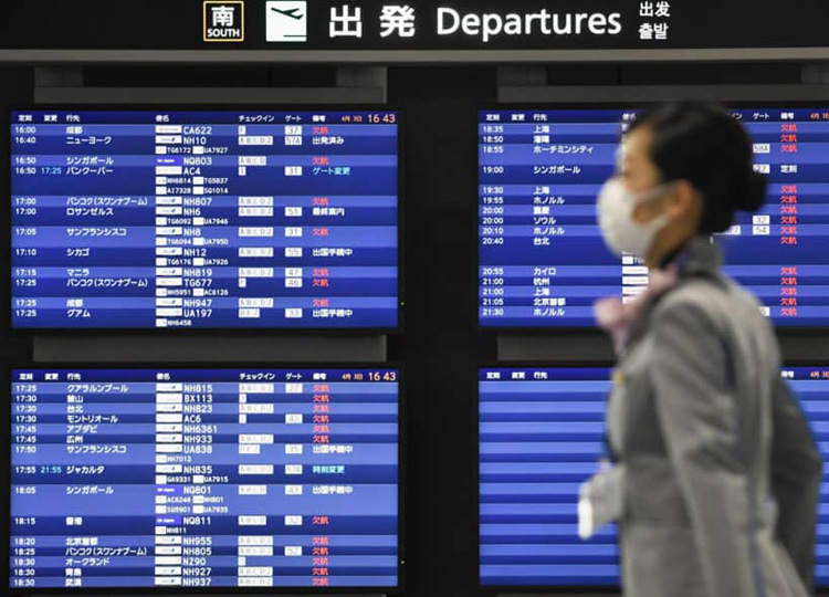 A departure board at Narita Airport near Tokyo shows most flights canceled on April 3 amid the spread of COVID-19.