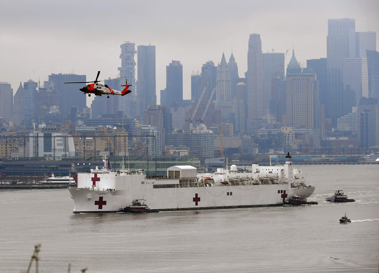 The U.S. Navy hospital ship Comfort arrives in New York City's Hudson River, as seen from Weehawken, New Jersey.