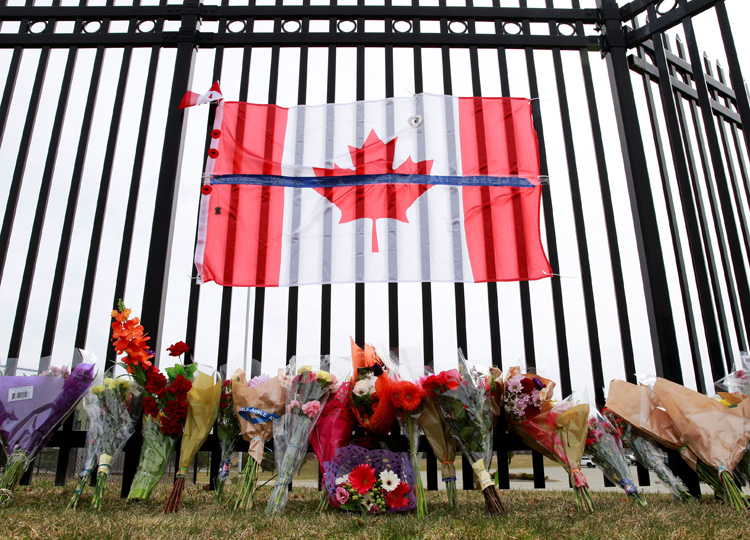 A memorial for Const. Heidi Stevenson is seen outside Royal Canadian Mounted Police Headquarters in Dartmouth, a community in the Canadian province of Nova Scotia, on April 20.