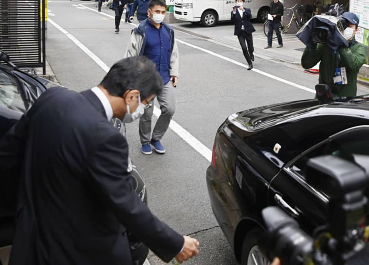 Hiromu Kurokawa walks to a car parked in front of his house in Tokyo on May 21.