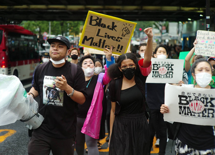 Black Lives Matter Tokyo organizers lead protesters on a march through the capital's Shibuya district on June 14.
