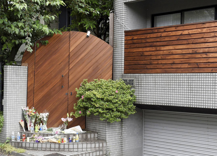 Flowers are placed at a shooting location for Terrace House in Tokyo on May 25. Hana Kimura, a cast member of the show, died by suspected suicide May 23.