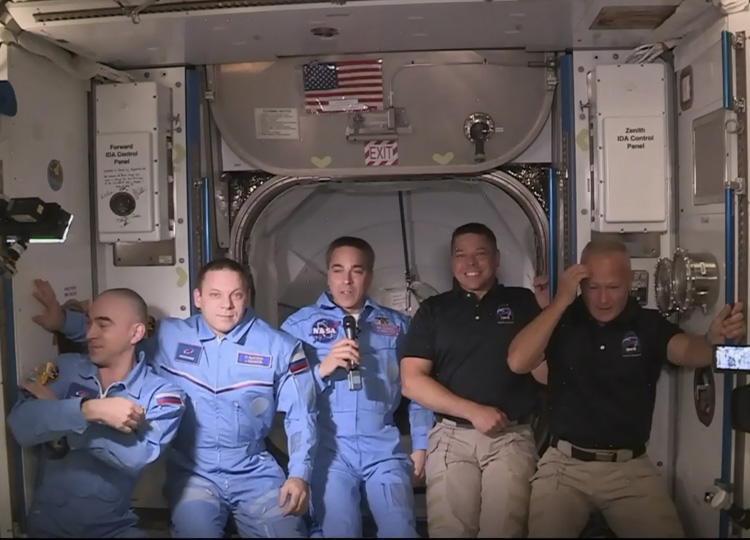 SpaceX astronauts Douglas Hurley (right) and Robert Behnken (2nd from right) pose with other astronauts on the International Space Station on May 31.