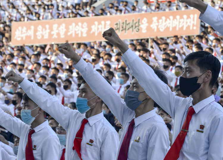North Korean youth and students hold an outdoor rally in Pyongyang on June 7 to protest leaflets launched by defectors in South Korea condemning Kim Jong Un's regime.