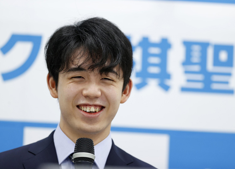 Sota Fujii speaks at a news conference in Osaka on July 17, a day after becoming the youngest shogi player ever to win one of the board game's eight major titles.