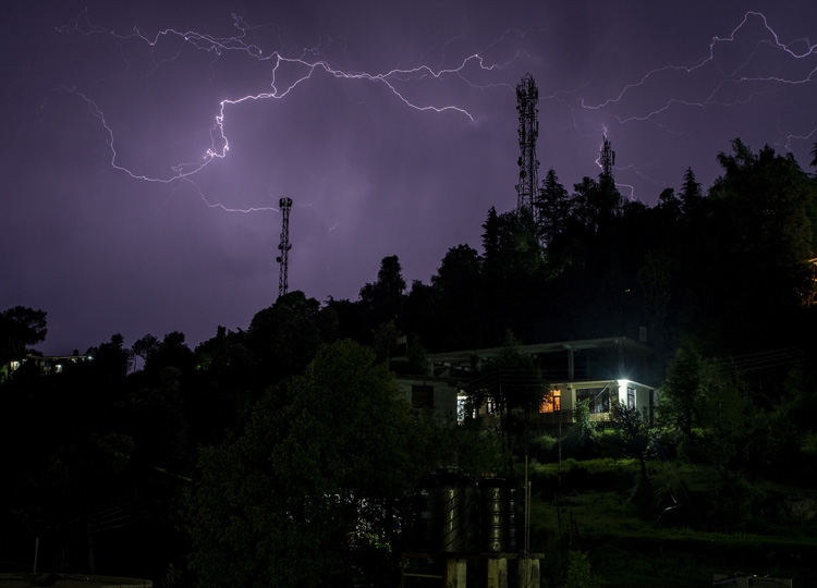 Streaks of lightning are seen above a township in Dharamsala, India, on June 4.