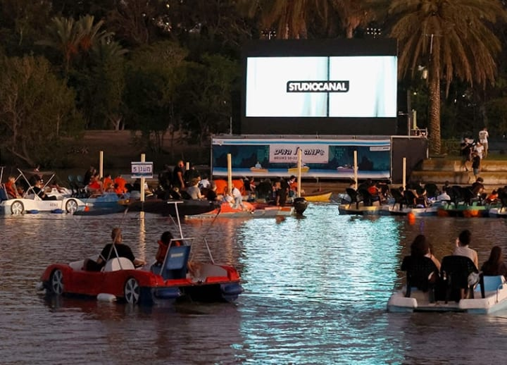 Israel's new coronavirus-safe cinema has moviegoers watching from pedal boats
