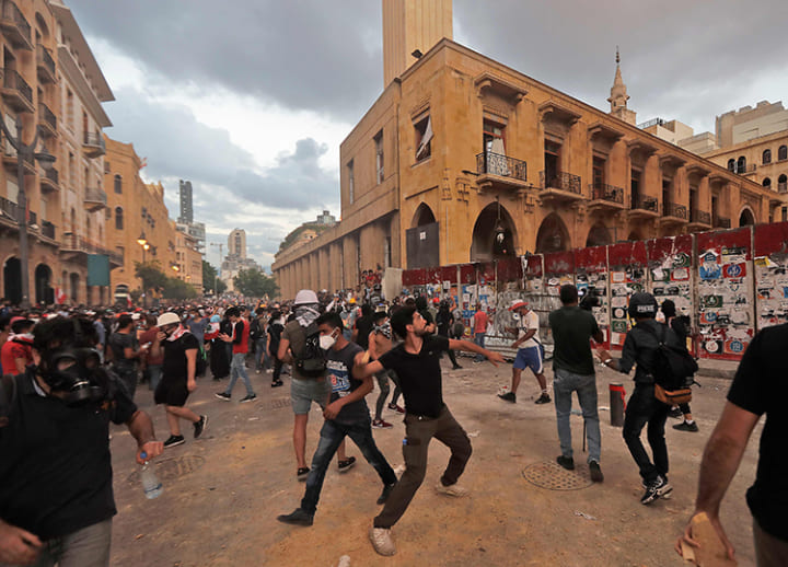 Lebanese government resigns, bowing to public anger over deadly Beirut blast
