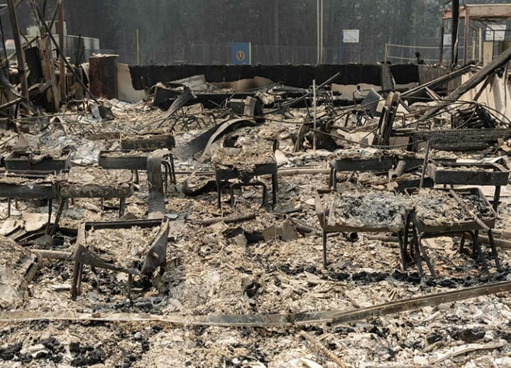 Search crews scour landscape, as Oregon residents return to wildfire-damaged rubble