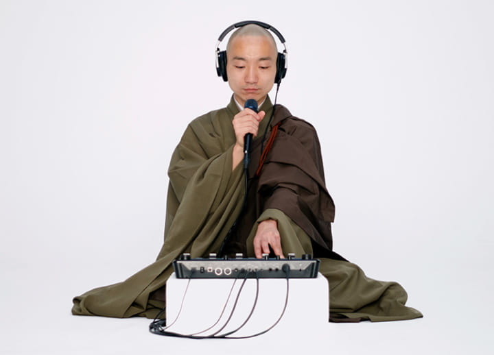 Reaching out to the world with Buddhism and music