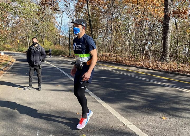 Blind man completes solo 5K run with trial Google system to guide him