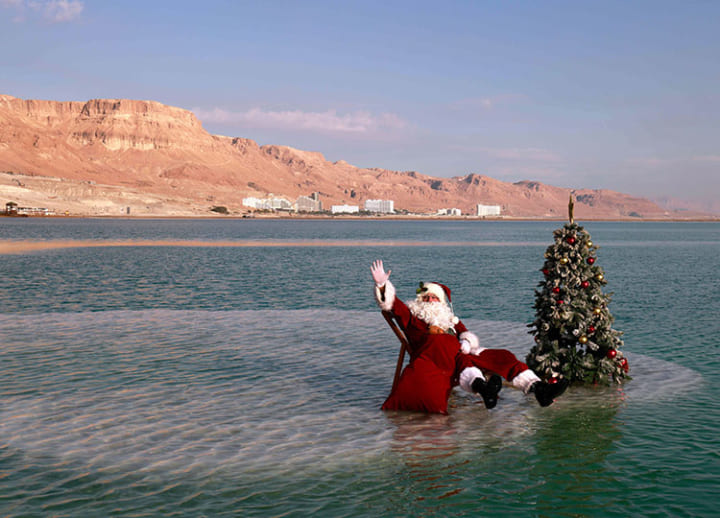 Santa plants tree on island in Dead Sea, bringing festive spirit ahead of Christmas
