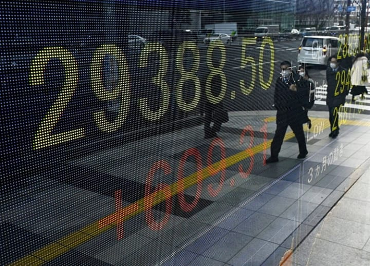 Tokyo stocks end at 30-year high on global economic recovery hopes
