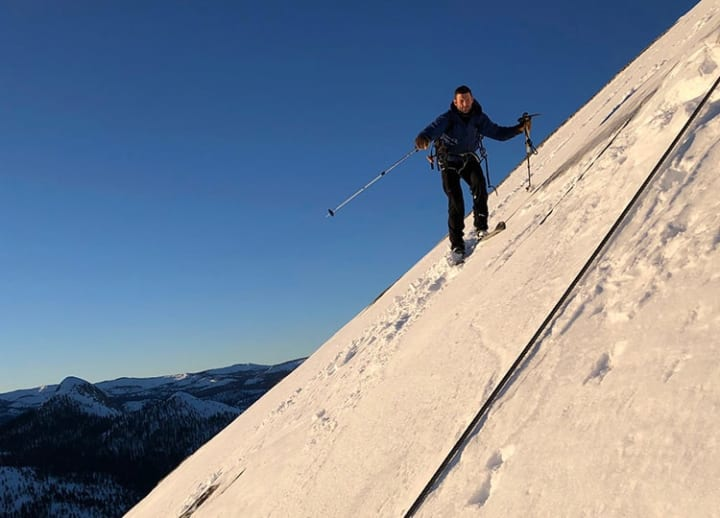 Death-defying feat: Skiers descend slowly down Yosemite's Half Dome