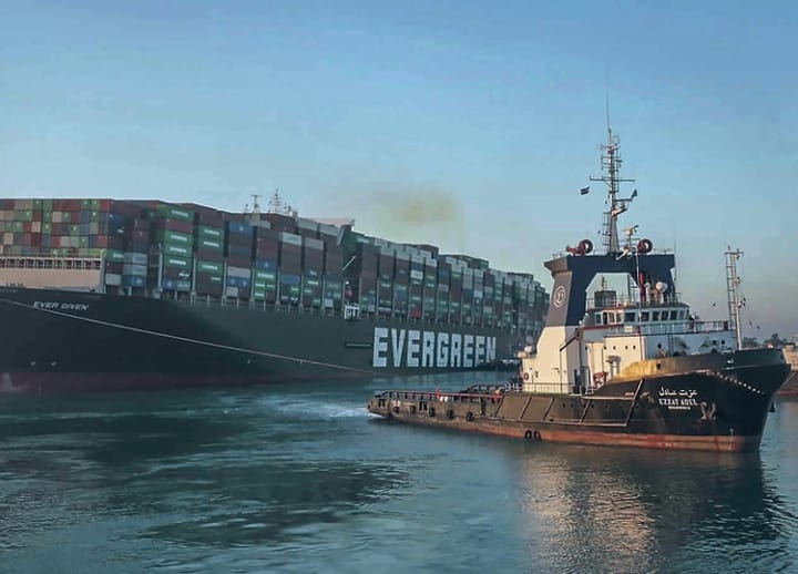 'We pulled it off!' Suez Canal tugboats pull ship from bank