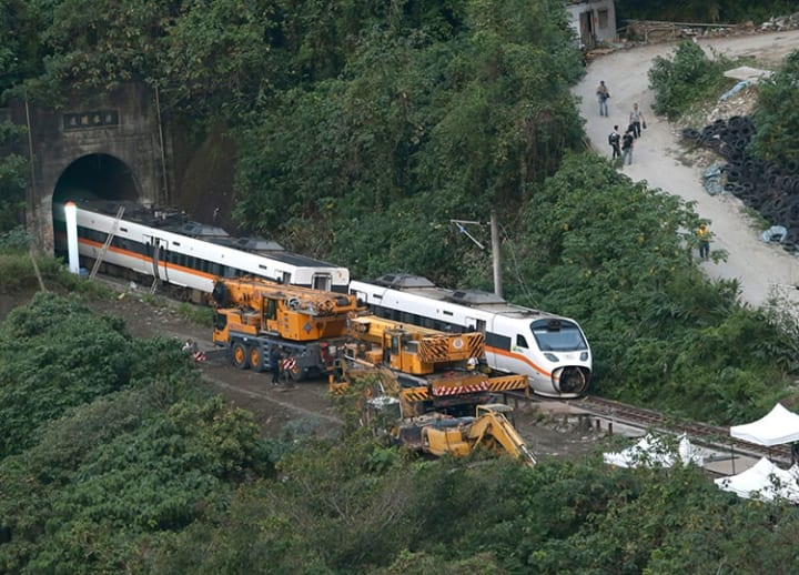 Man apologizes after failing to secure truck that caused deadly Taiwan railway crash