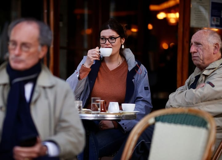 Parisians tuck into coffee, croissants again as cafes reopen for outdoor dining