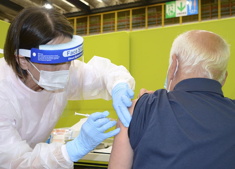 A man receives a COVID-19 vaccine shot in Kitakyushu on April 12.