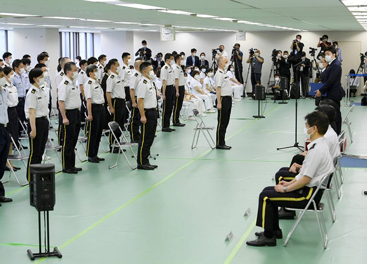 Medical staff from the Self-Defense Forces gather at a vaccination center in Tokyo on May 17 to prepare for the start of mass vaccinations starting May 24.