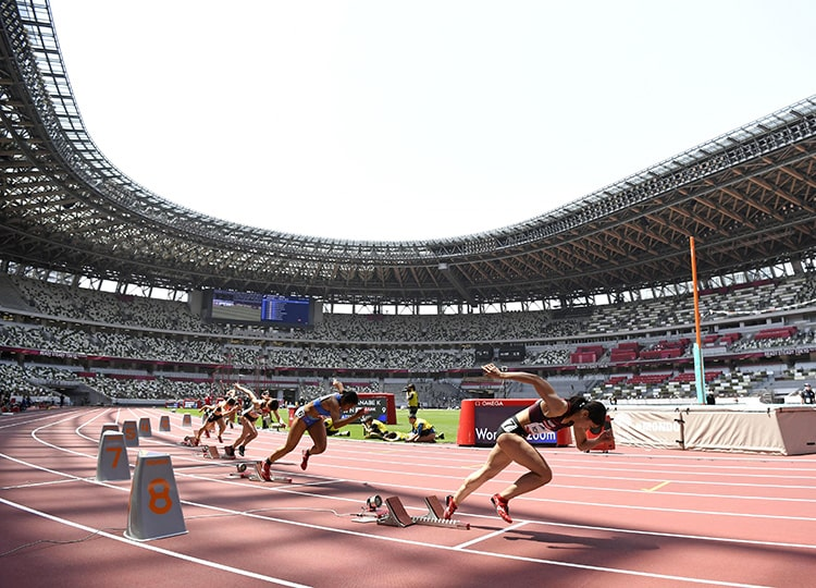 Athletes participate in an Olympic test event at the National Stadium on May 9. Spectators were not allowed inside the stadium.