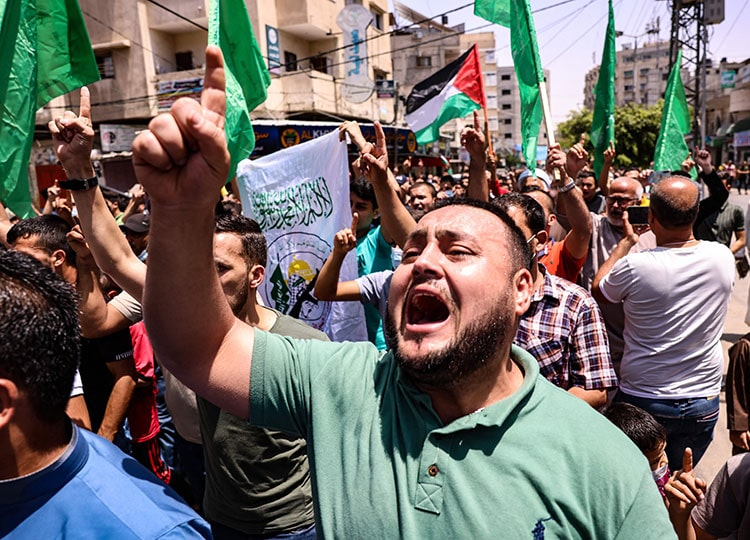 Palestinian supporters of Hamas celebrate in the southern Gaza Strip city of Khan Younis on May 21 after a cease-fire was brokered by Egypt between Hamas and Israel.