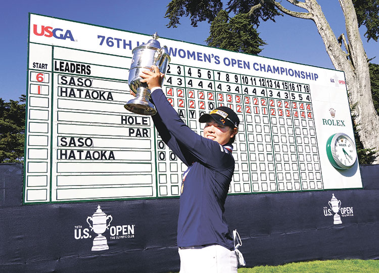 Yuka Saso hoists the U.S. Open trophy after winning the U.S. Women's Open golf tournament at The Olympic Club in San Francisco on June 6.