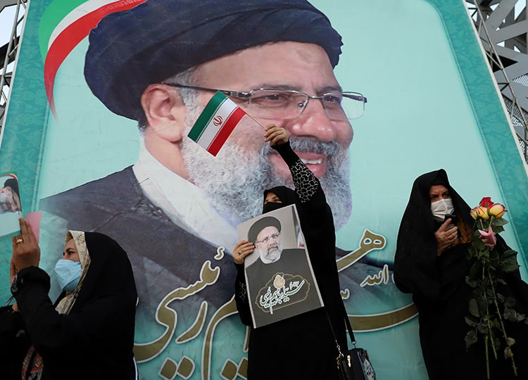 A supporter of Ebrahim Raisi displays his portrait during a celebratory rally for his presidential election victory in Tehran on June 19.