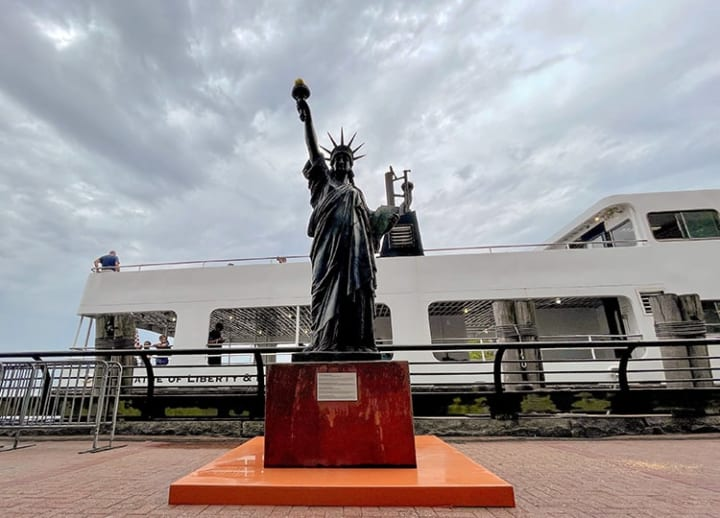 Mini Statue of Liberty follows her big sister's steps to New York Harbor