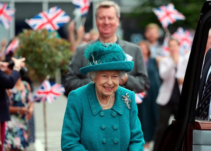Queen Elizabeth II visits set of TV soap Coronation Street on its 60th anniversary