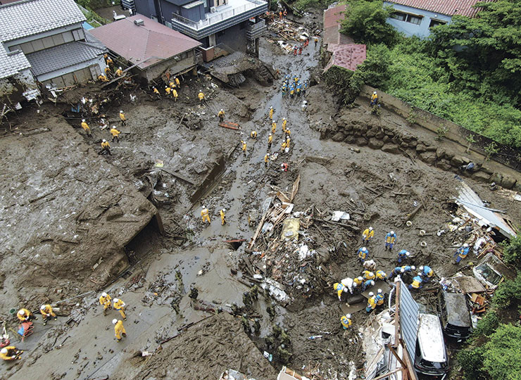 Rescuers search the site of a mudslide at the Izusan neighborhood in the city of Atami, Shizuoka Prefecture, on July 6.