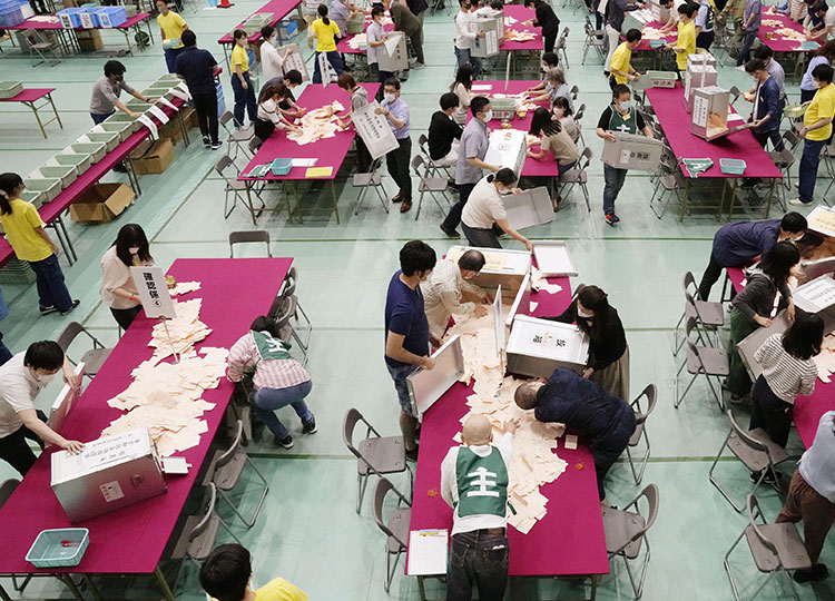 Election workers in Tokyo's Nerima Ward count votes for the Tokyo metropolitan assembly election on July 4.