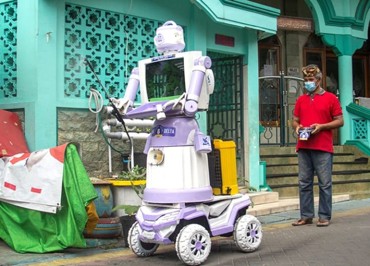 Robot made out of trash helps COVID-19 patients in Indonesian village