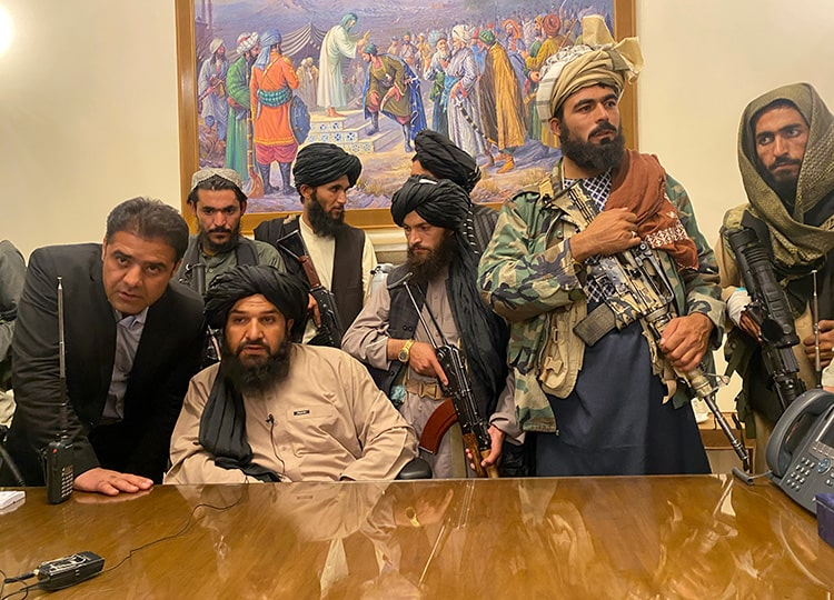 Taliban fighters take control of the Afghan presidential palace in Kabul after Afghan President Ashraf Ghani fled the country on Aug. 15.