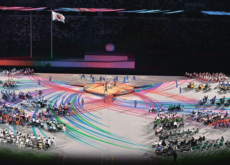 Performers and delegations take part in the opening ceremony for the Tokyo 2020 Paralympic Games at the National Stadium in Tokyo on Aug. 24.