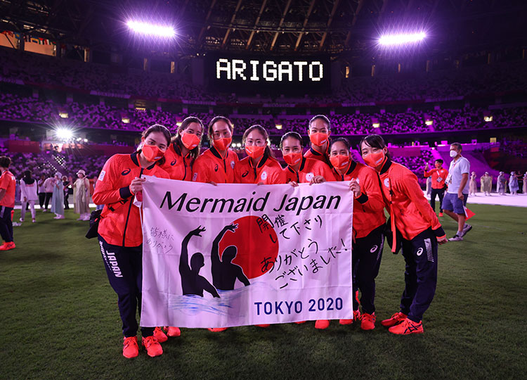 Japan's artistic swimming team poses for a photo during the closing ceremony of the Tokyo Olympics on Aug. 8.