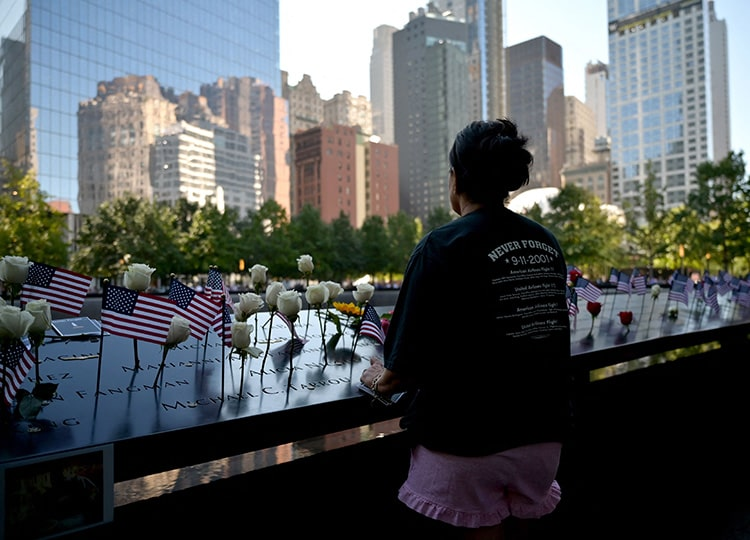 Flags and flowers adorn the National 9/11 Memorial during the ceremony commemorating the 20th anniversary of the 9/11 attacks on the World Trade Center in New York on Sept. 11.